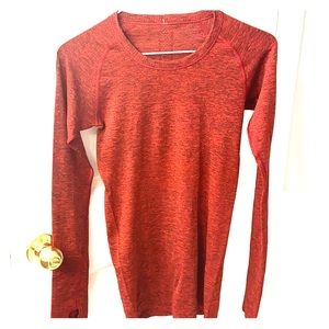Red long sleeve swiftly shirt. Tight fit